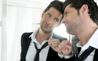 Man looking in the mirror