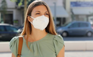 Woman outside wearing mask